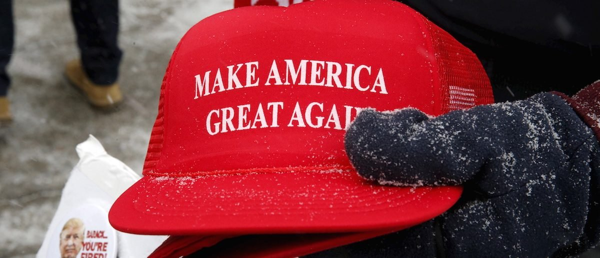 """Make America Great Again"" hats dusted with falling snow. REUTERS/Jim Bourg"