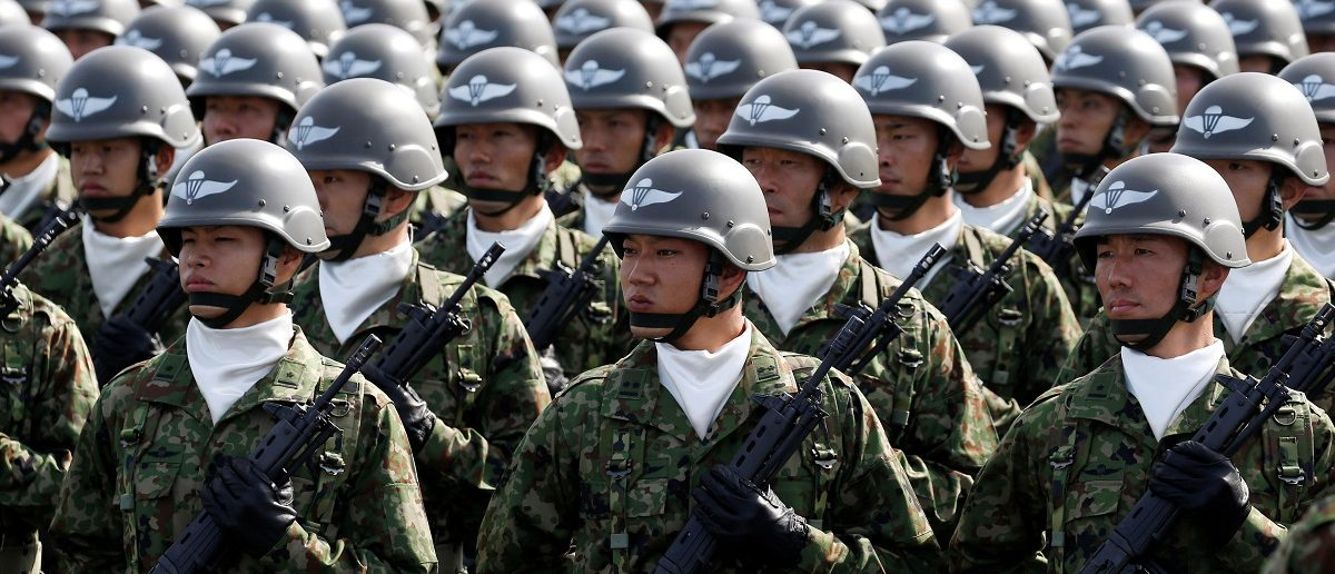 Members of Japan's Self-Defence Forces' airborne troops stand at attention during the annual SDF ceremony at Asaka Base, Japan, October 23, 2016. REUTERS/Kim Kyung-Hoon