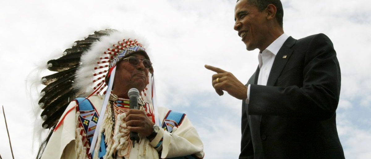 US Democratic presidential candidate Barack Obama, talks to Carl Venne, chairman of the Crow tribe, at a campaign rally in Crow Agency in 2008. REUTERS/Rick Wilking