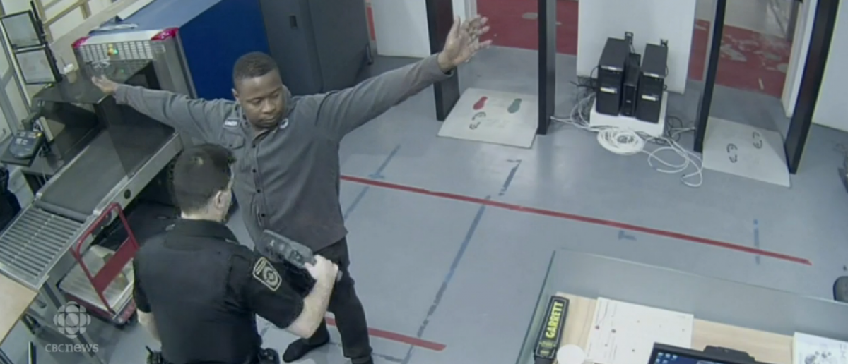 Leston Lawrence walking through Royal Canadian Mint security checkpoint. [Screenshot/CBC News Video]