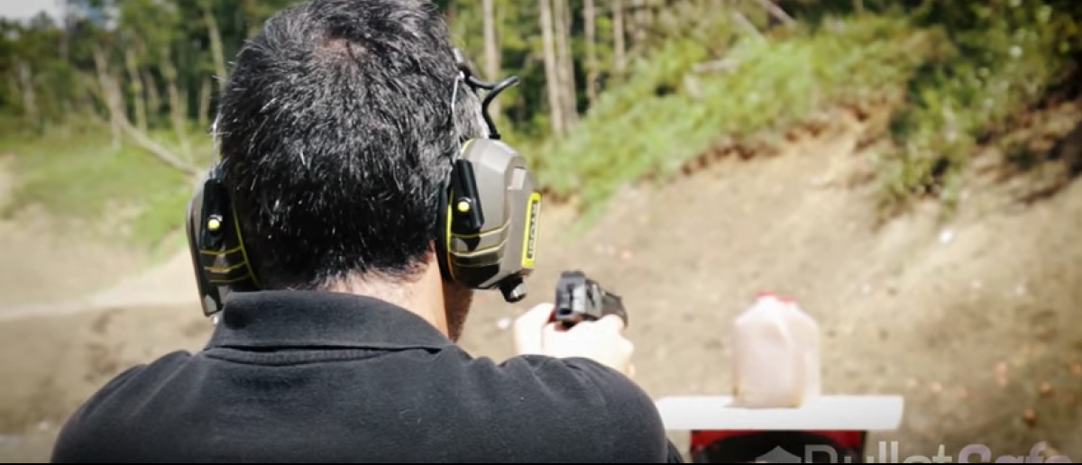 Tom from BulletSafe shoots at jugs of apple cider (BulletSafe/YouTube screenshot)