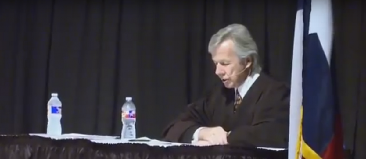 U.S. Magistrate Judge John Primomo presides over a new citizenship ceremony. Credit: YouTube screen grab https://www.youtube.com/watch?v=avPF6746duE