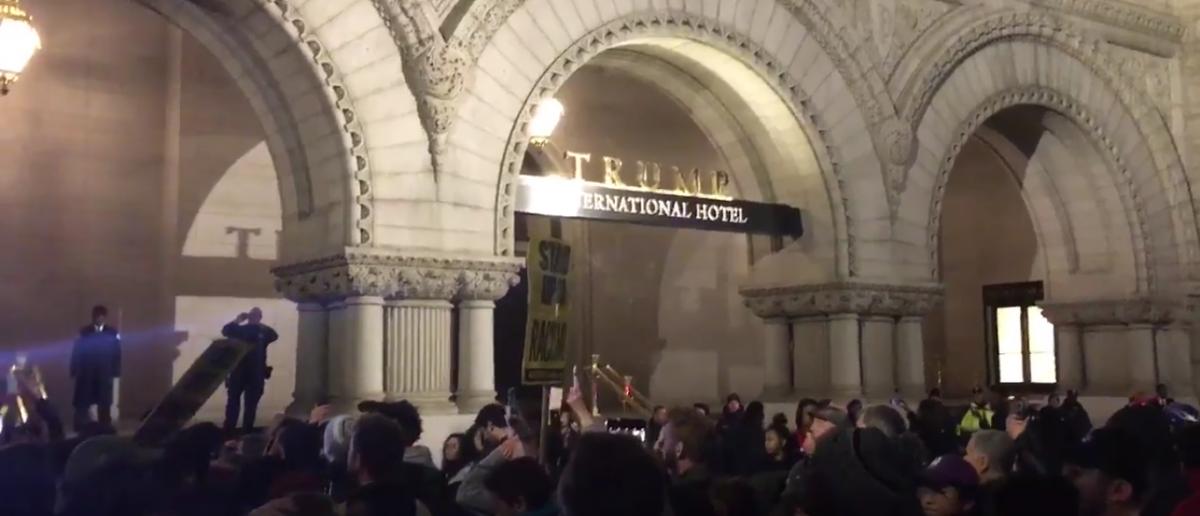 Protests at Trump International Hotel. (Natalie DiBlasio/Twitter/Screenshot)