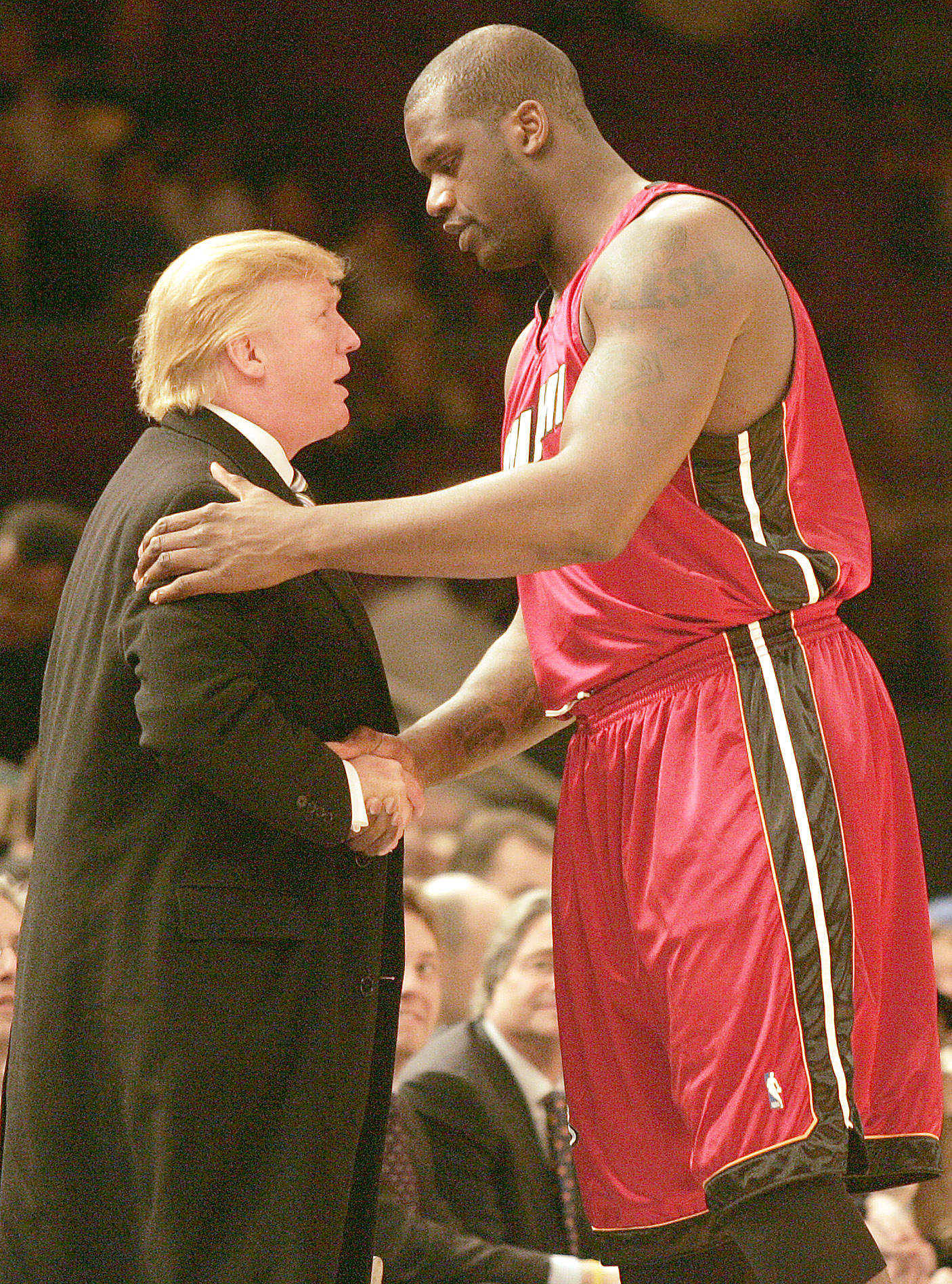 Donald Trump and Shaquille O'Neal shake hands at a game between the Knicks and Heat. (Photo credit: Splash News)