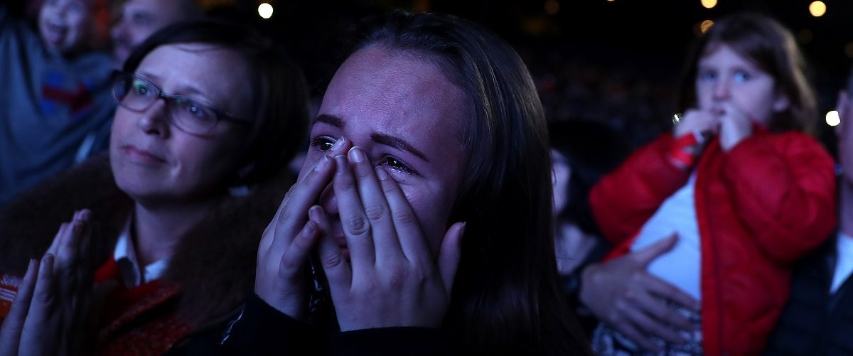 A young supporter cries as Democratic presidential nominee former Secretary of State Hillary Clinton speaks during a Get Out The Vote concert at the Mann Center for the Performing Arts on November 5, 2016 in Philadelphia, Pennsylvania. With three days to go until election day, Hillary Clinton is campaigning in Florida and Pennsylvania.  (Photo by Justin Sullivan/Getty Images)