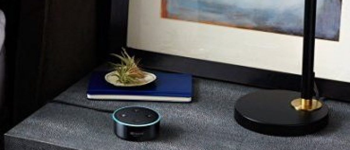 The Echo Dot is much smaller than the Echo and only $40 today (Photo via Amazon)