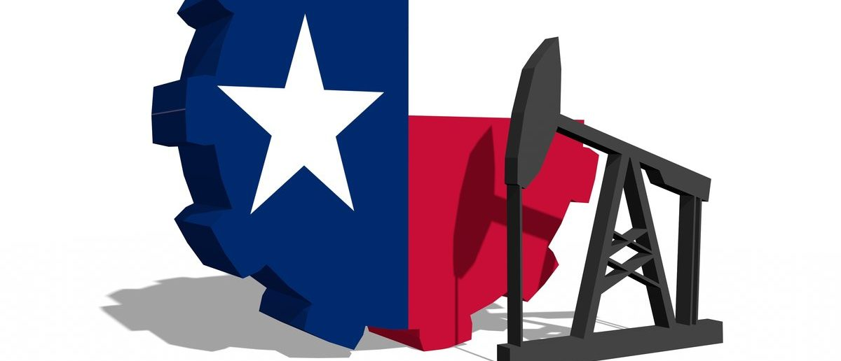Texas oil industry, state flag on gear and derrick model near (Shutterstock/GrAl)