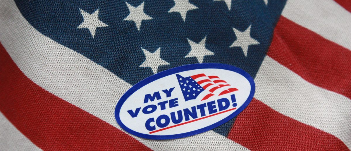 My Vote Counted Sticker on American Flag (Shutterstock/cpreiser000)