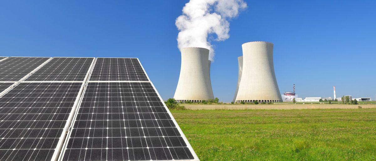 Solar panels and nuclear power plant (Shutterstock/jaroslava V)
