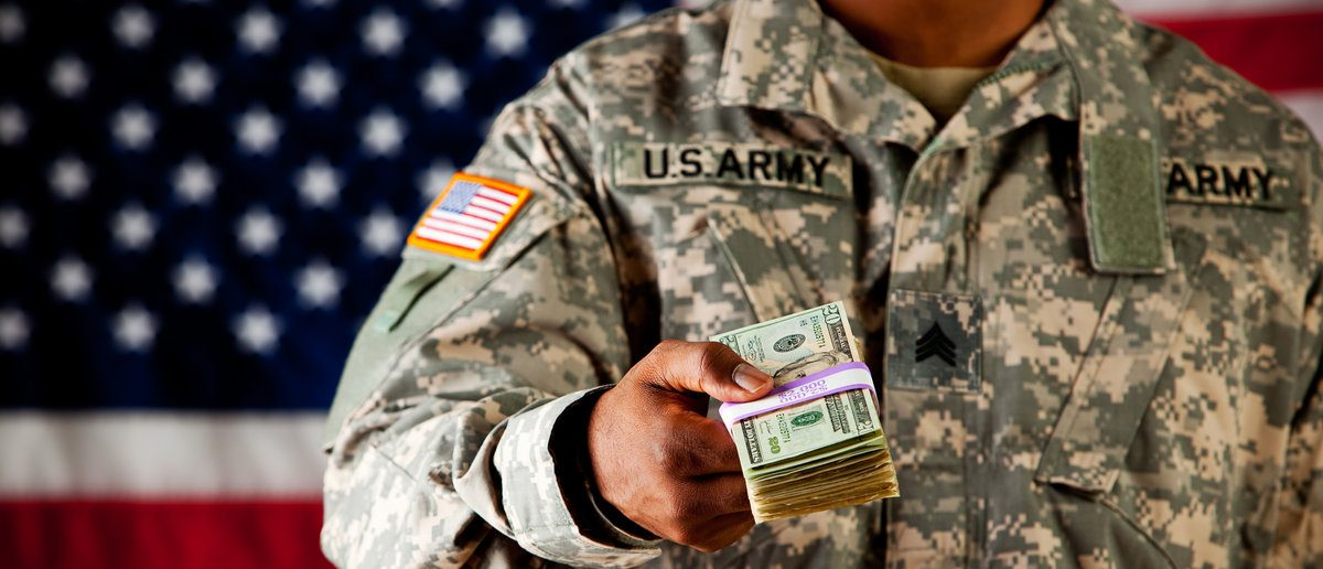 Soldier: Holding Out Cash (Shutterstock.com/Sean Locke Photography)