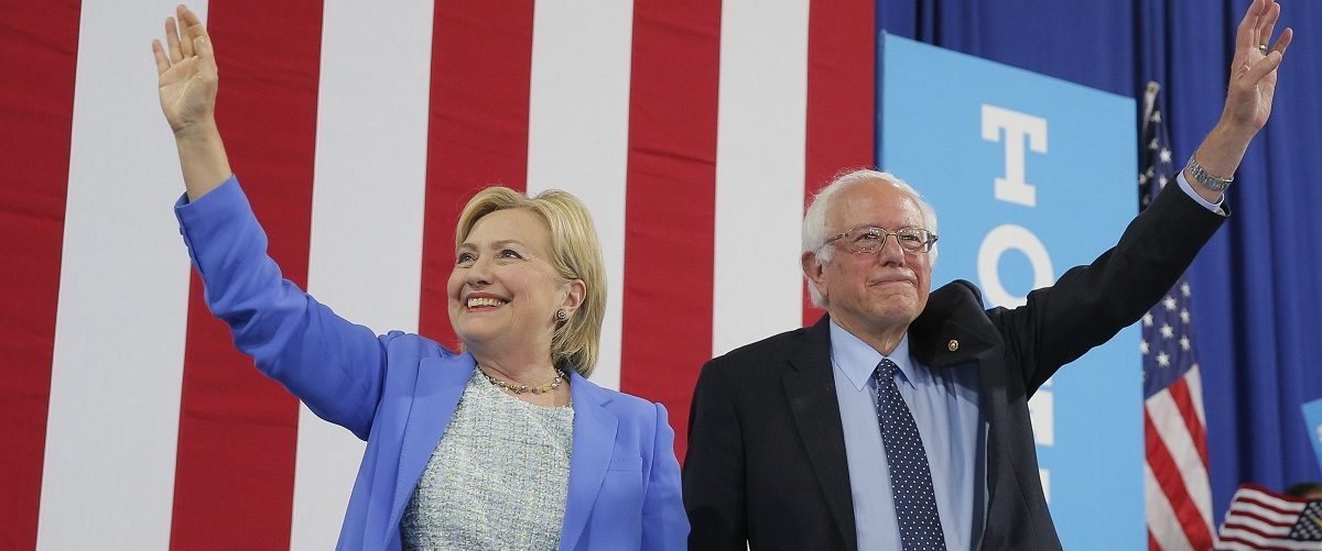 Democratic U.S. presidential candidate Hillary Clinton and Sen. Bernie Sanders stand together during a campaign rally where Sanders endorsed Clinton in Portsmouth, New Hampshire, U.S., July 12, 2016. REUTERS/Brian Snyder.