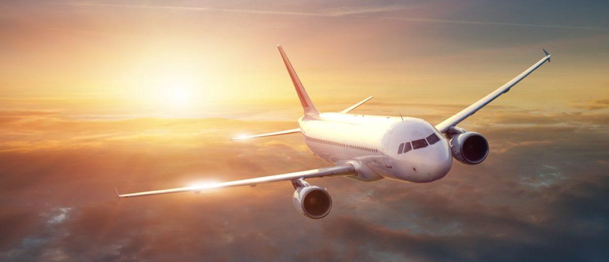 An aircraft flies during sunset. Source: Shutterstock/IM_photo