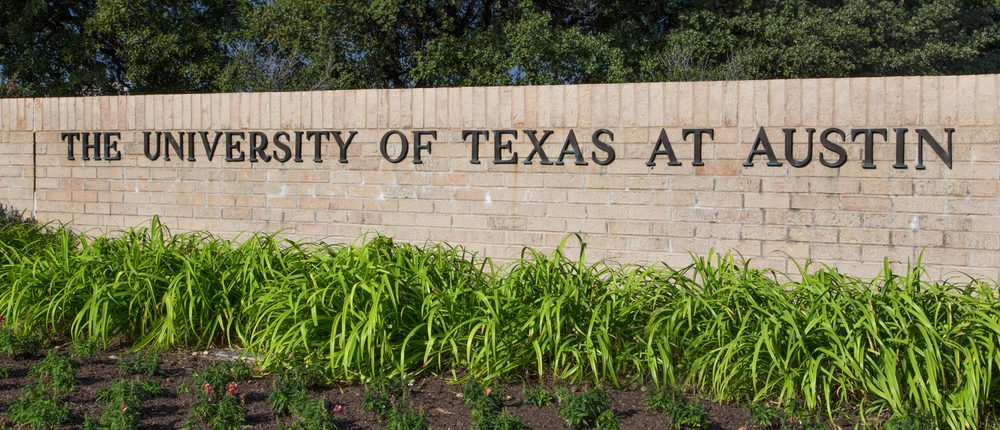 Entrance Sign to the campus of the University of Texas, a state research university and the flagship institution of the The University of Texas System. November 14, 2013. (Shutterstock)