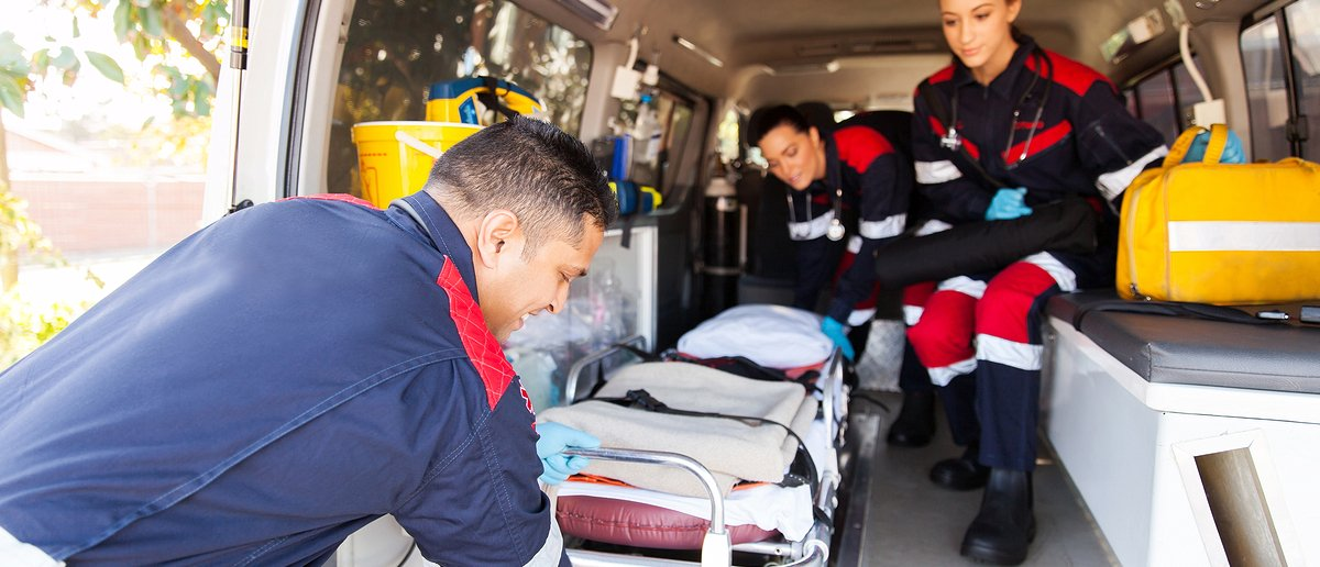 Paramedics unload stretcher from an ambulance Photo: Shutterstock/ michaeljung