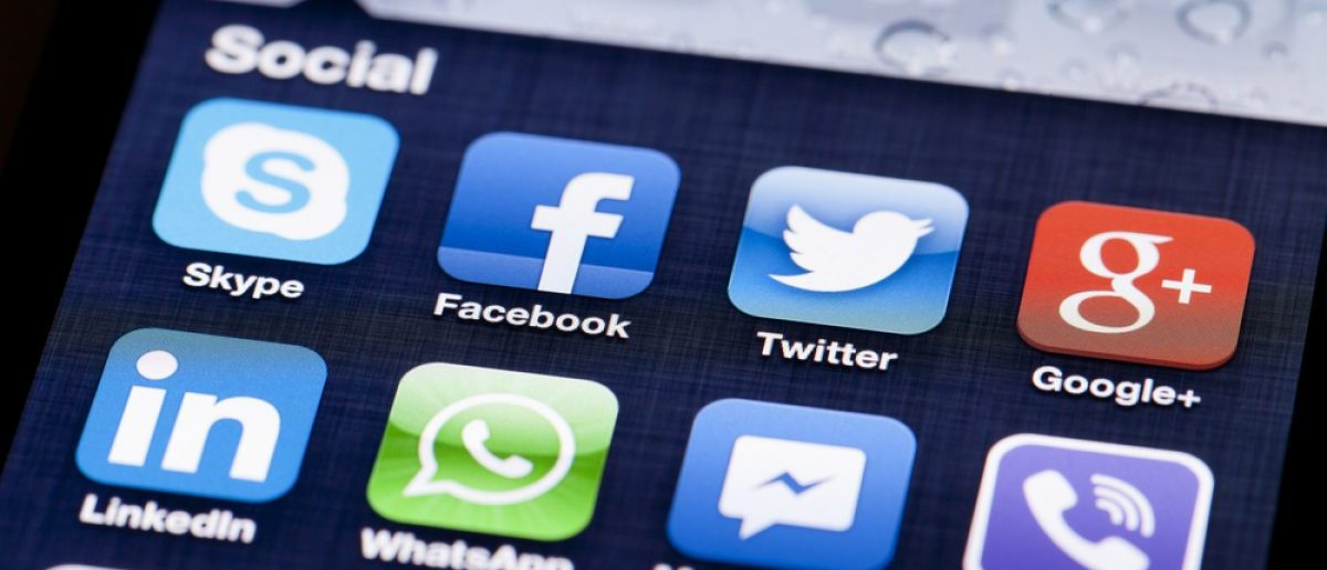 Facebook, Twitter, Google all on smartphone screen. [Shutterstock - ymgerman]