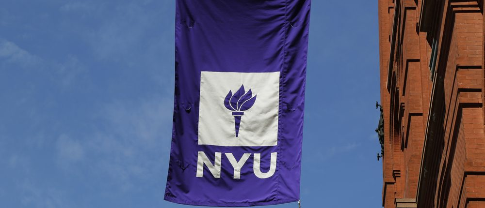 New York University flag on historic Puck Building at Wagner Graduate School of Public Service in Lower Manhattan (Photo: Shutterstock)