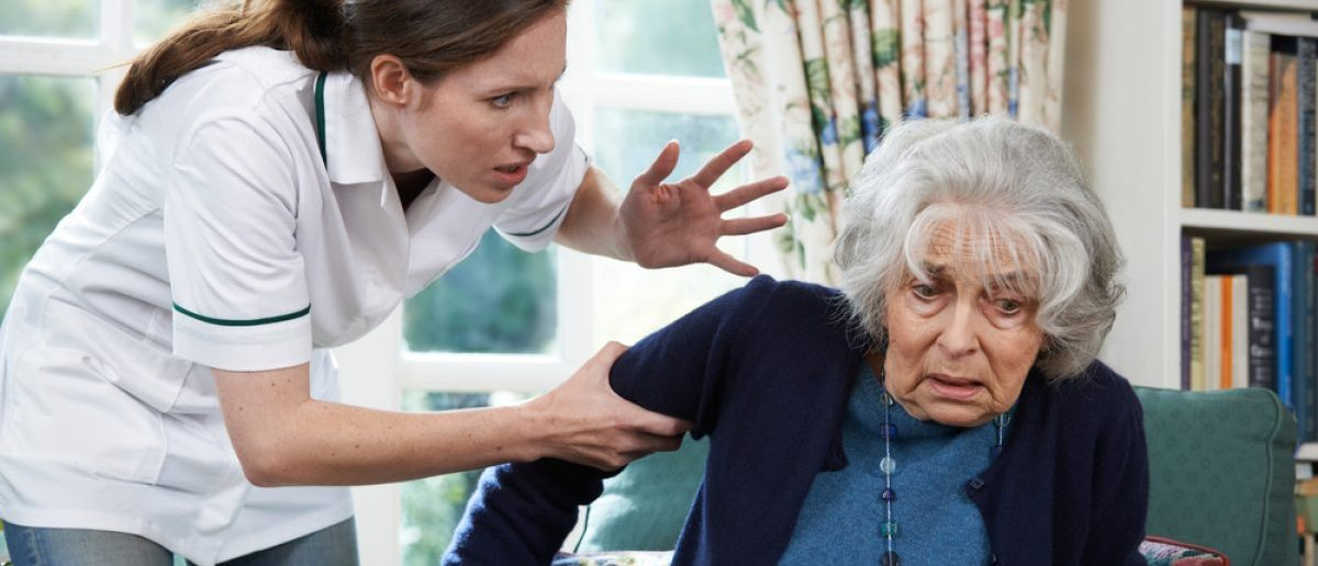 Care Worker Helping An Elderly Woman. [Shutterstock - SpeedKingz]