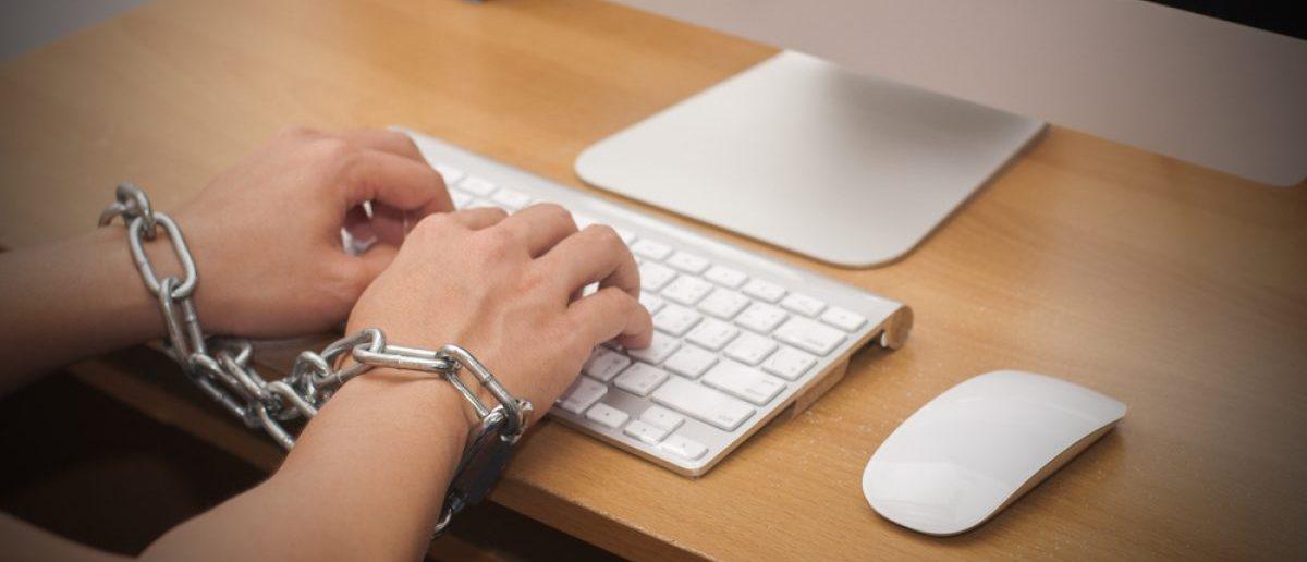 Internet user arrested after illegal activity. [Shutterstock - Joe Techapanupreeda]