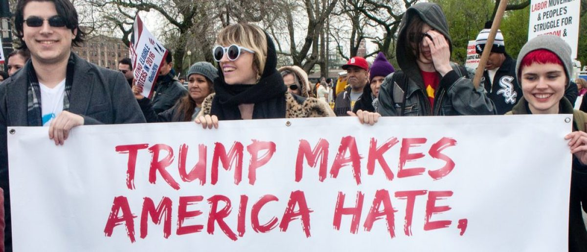 Hundreds of marchers turned up on May Day to unite around a protest of Trump on the right wing agenda against all workers and immigrants. (Marie Kanger Born/Shutterstock.com)