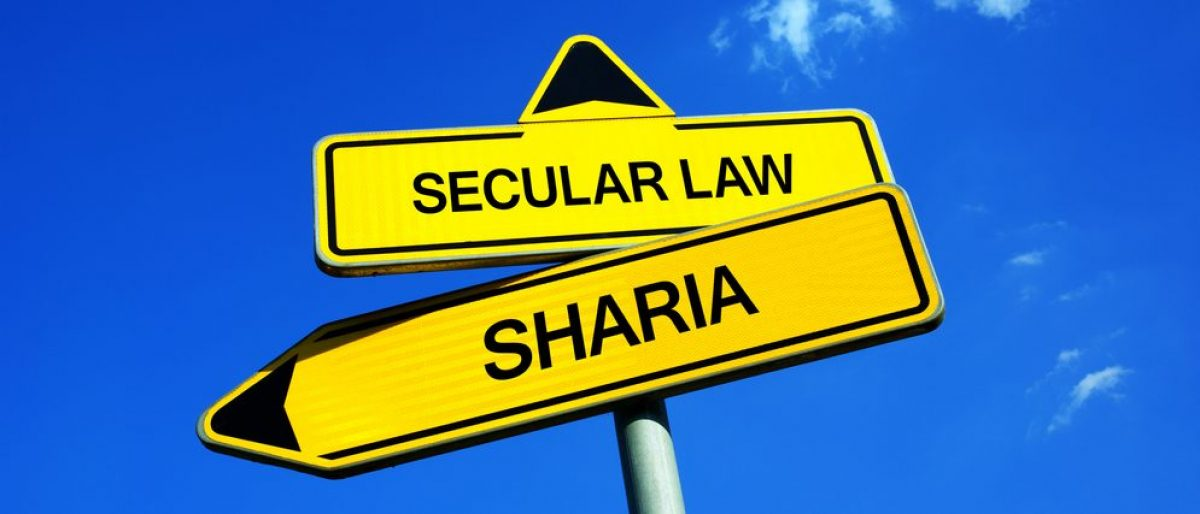 Secular Law vs Sharia - Traffic sign with two options - Justice based on secularism or court and legislation based on religious belief of Islam. (Photo credit: Shutterstock.com)