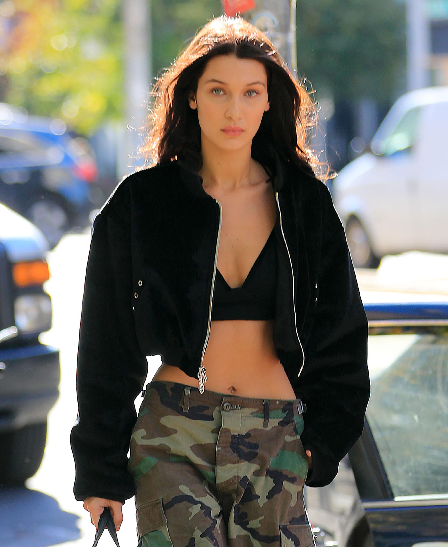 Bella Hadid bears her sexy stomach walking the streets of NYC. (Photo credit: Splash News)