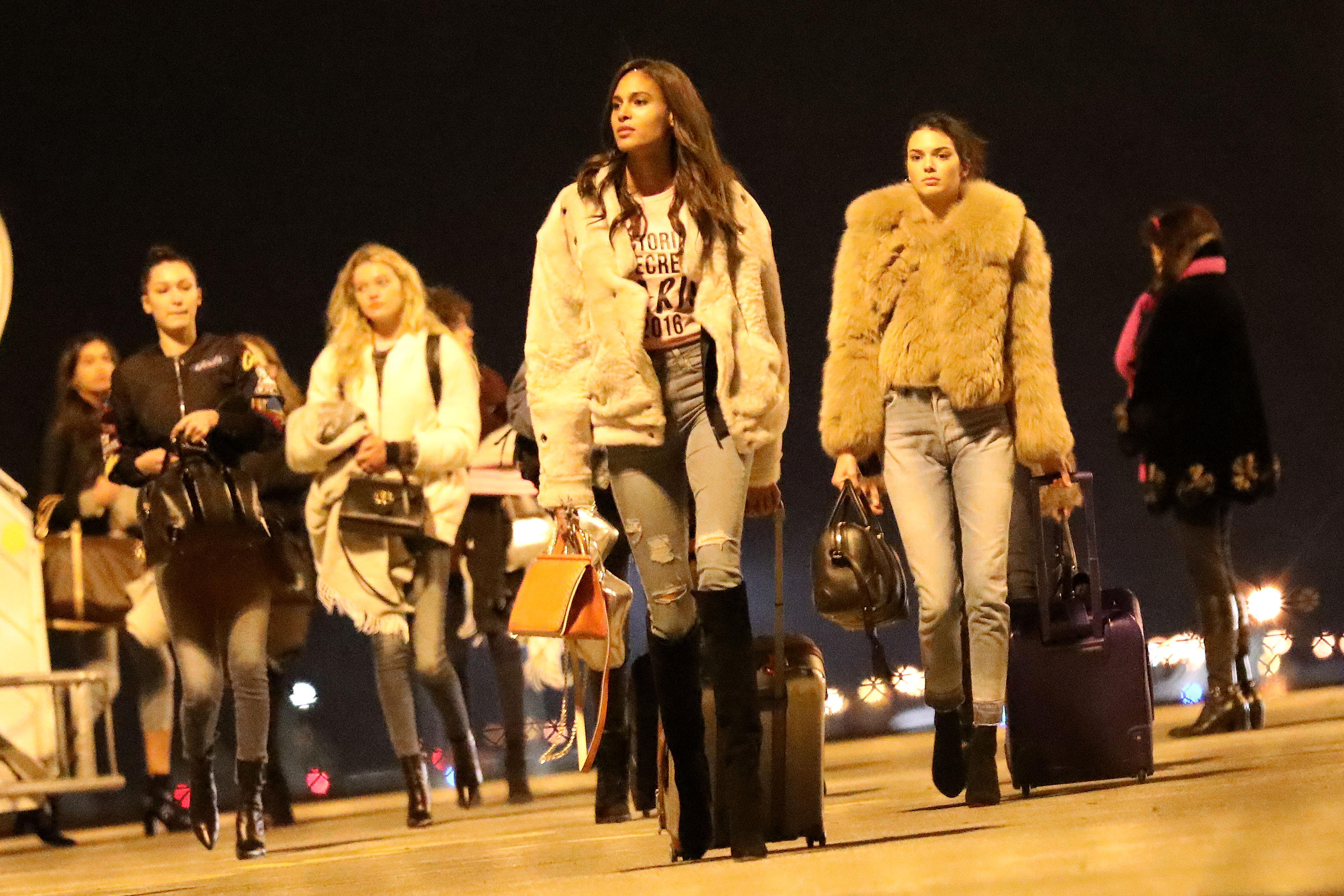 The Victoria's Secret Angels arrive in Paris. (Photo credit: Splash News)