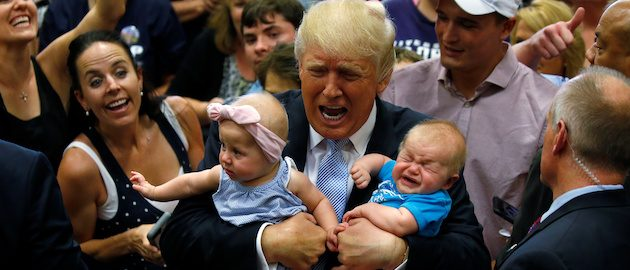 Republican presidential nominee Donald Trump holds babies at a campaign rally in Colorado Springs, Colorado, U.S., July 29, 2016. REUTERS/Carlo Allegri    TPX IMAGES OF THE DAY      - RTSKBQJ