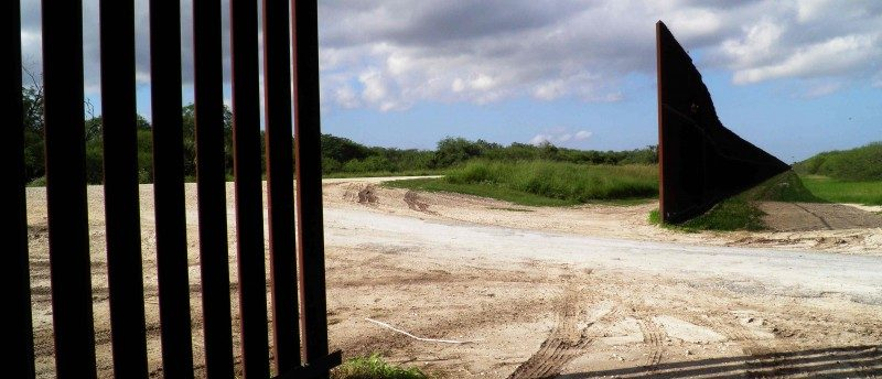 A gap to make way for a road in the U.S. border fence is seen in Brownsville, Texas, U.S. on November 17, 2016. REUTERS/Jon Herskovitz