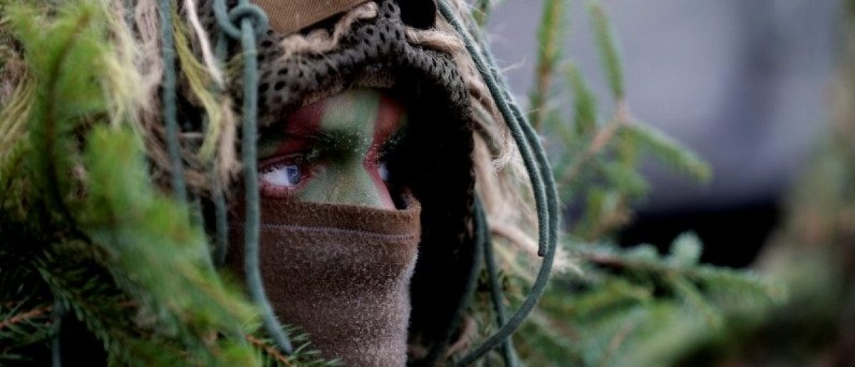 Lithuanian army soldier with the other troops from 11 NATO nations takes part in the exercise in urban warfare during Iron Sword exercise in the mock town near Pabrade, Lithuania, December 2, 2016. REUTERS/Ints Kalnins