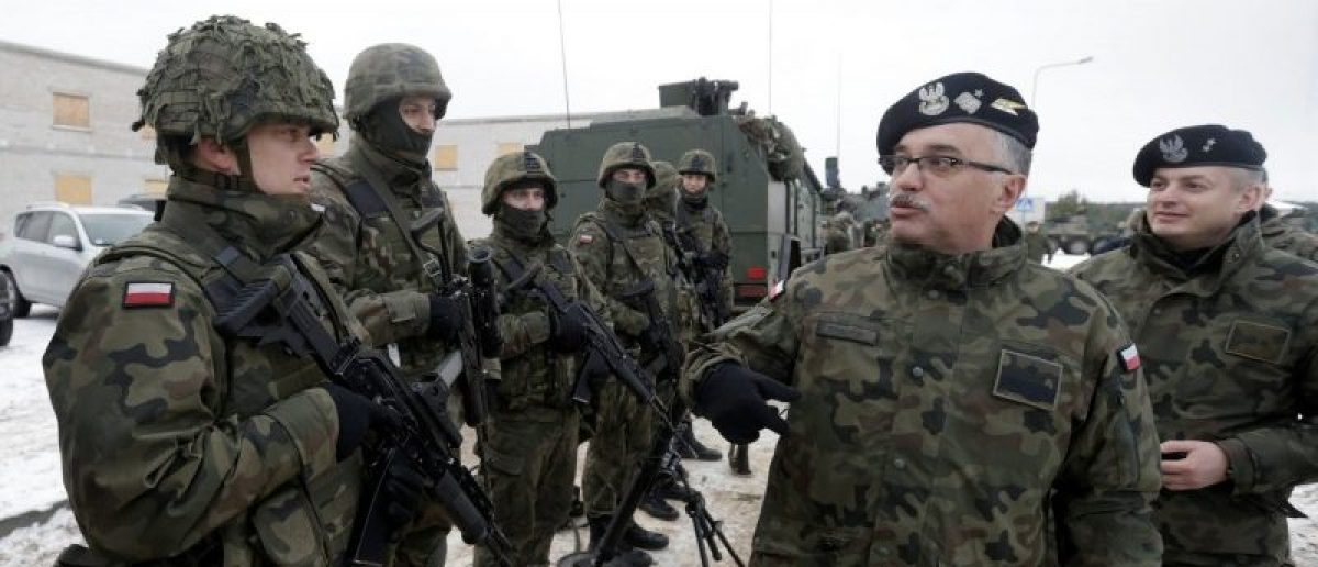 Poland's troops along with the other troops from 11 NATO nations take part in the exercise in urban warfare during Iron Sword exercise in the mock town near Pabrade, Lithuania, December 2, 2016. REUTERS/Ints Kalnins
