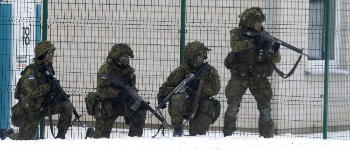 Estonian troops along with the other troops from 11 NATO nations take part in the exercise in urban warfare during Iron Sword exercise in the mock town near Pabrade, Lithuania, December 2, 2016. REUTERS/Ints Kalnins