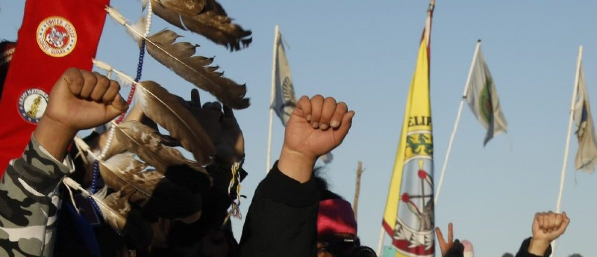 """Native American """"water protectors"""" celebrate that the Army Corps of Engineers has denied an easement for the $3.8 billion Dakota Access Pipeline inside of the Oceti Sakowin camp as demonstrations continue against plans to pass the Dakota Access pipeline adjacent to the Standing Rock Indian Reservation, near Cannon Ball, North Dakota, U.S., December 4, 2016. REUTERS/Lucas Jackson"""