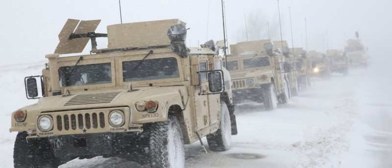North Dakota National Guard vehicles are parked on Highway 1806 during a march against the Dakota Access Oil Pipeline north of Backwater Bridge and the Oceti Sakowin Camp