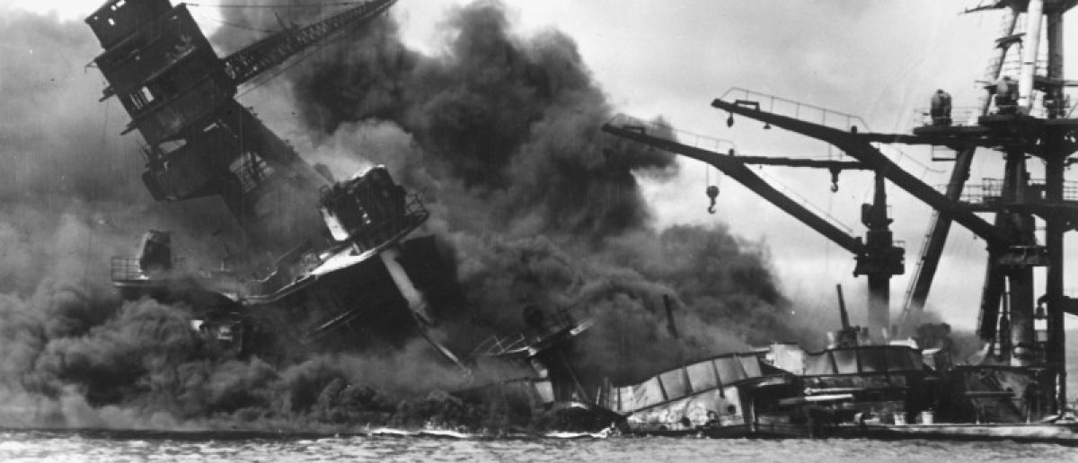 The battleship USS Arizona sinks after being hit by a Japanese air attack on Pearl Harbor, Hawaii, December 7, 1941. Picture taken December 7, 1941.    The U.S. National Archives/Handout via Reuters
