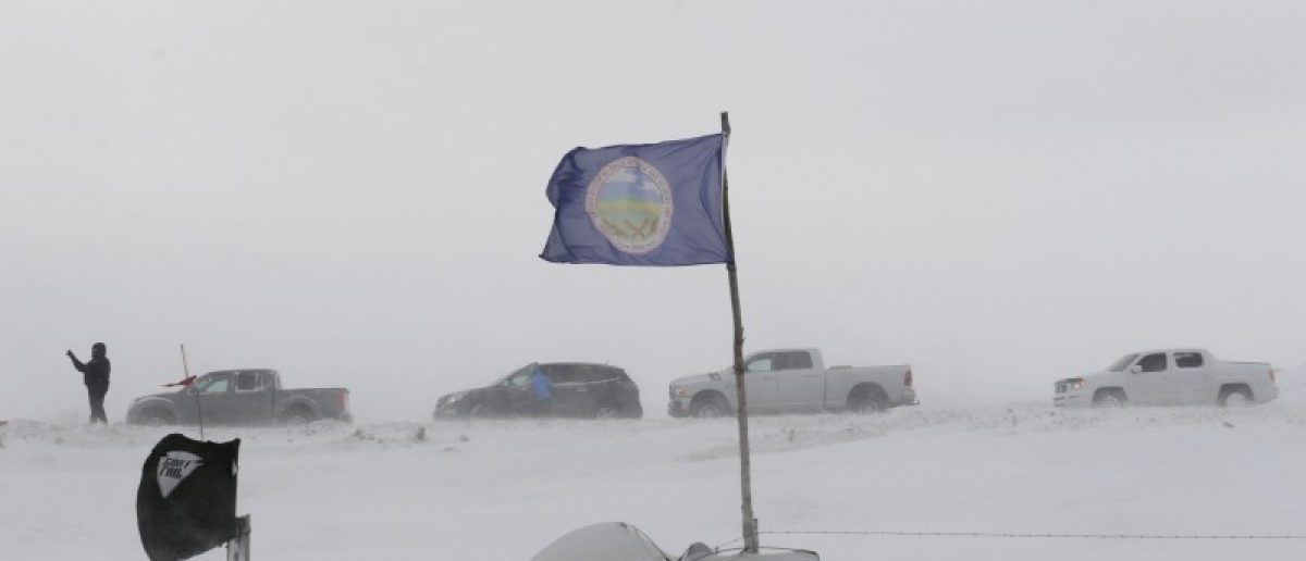 "People line up in their cars as they leave Oceti Sakowin camp as ""water protectors"" continue to demonstrate against plans to pass the Dakota Access pipeline near the Standing Rock Indian Reservation, near Cannon Ball, North Dakota, U.S. December 6, 2016."