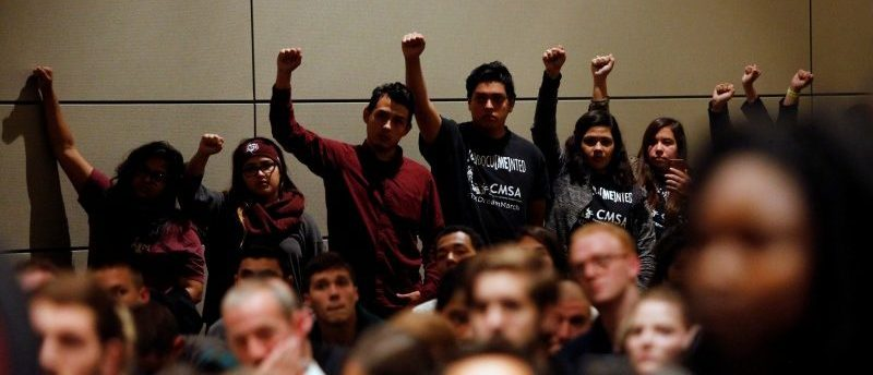 Undocumented Texas A&M students and their supporters protest silently as white nationalist leader Richard Spencer of the National Policy Institute speaks on campus at an event not sanctioned by the school, at Texas A&M University in College Station, Texas, December 6, 2016. REUTERS/Spencer Selvidge