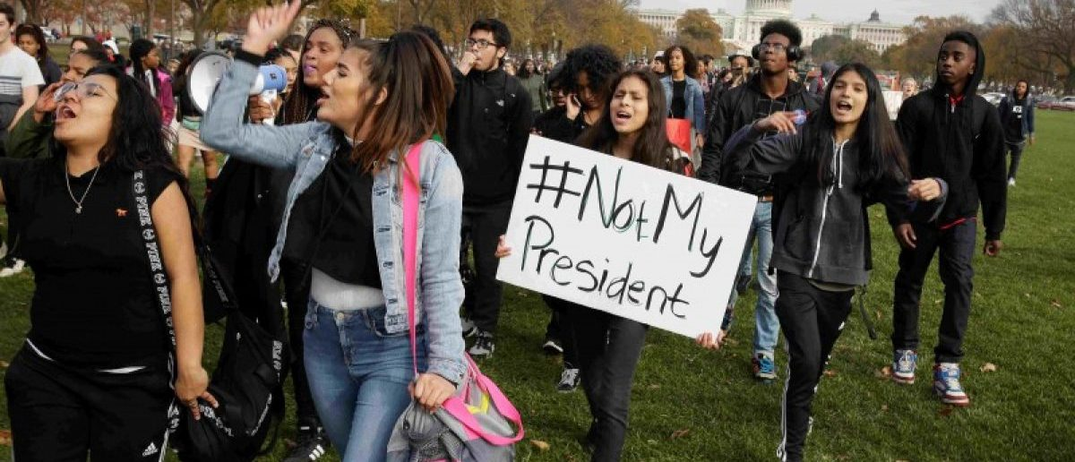 Students protest the election of President-elect Donald Trump during a march in Washington, U.S., November 15, 2016. REUTERS/Joshua Roberts/File Photo