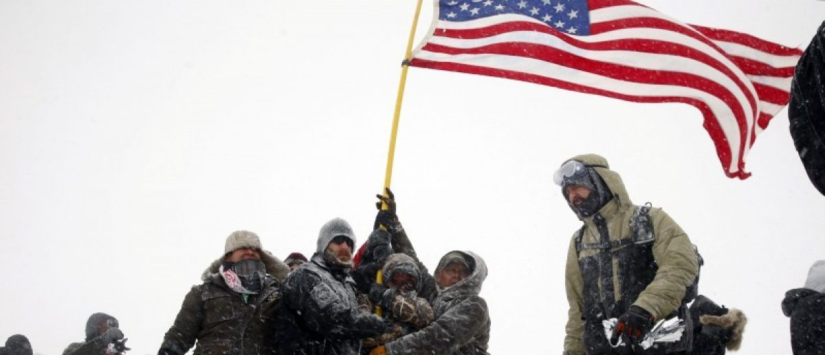 "Veterans join activists in a march to Backwater Bridge just outside of the Oceti Sakowin camp during a snow fall as ""water protectors"" continue to demonstrate against plans to pass the Dakota Access pipeline adjacent to the Standing Rock Indian Reservation, near Cannon Ball, North Dakota, U.S., December 5, 2016. REUTERS/Lucas Jackson"