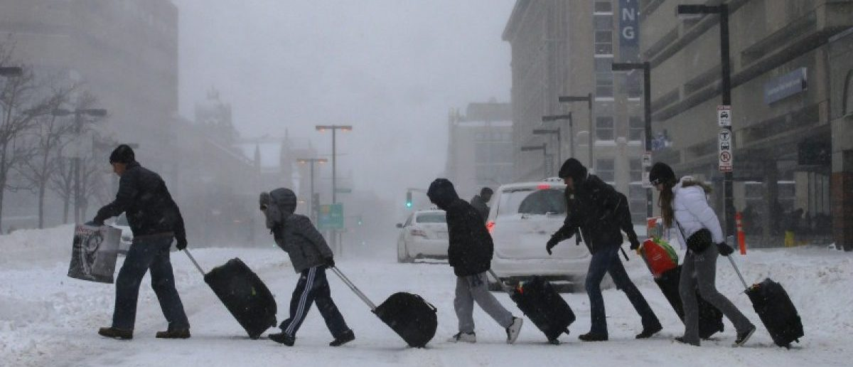 Travelers leave Back Bay train and subway station during winter polar vortex snow storm in Boston