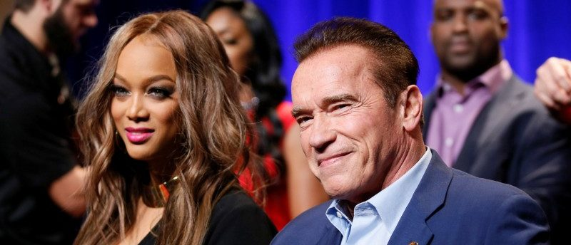 Host Arnold Schwarzenegger (R) and Tyra Banks participate in a panel for
