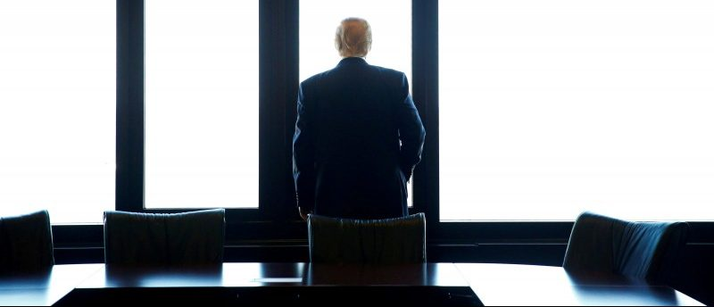 Donald Trump looks out at Lake Michigan during a visit to the Milwaukee County War Memorial Center in Milwaukee, Wisconsin, U.S. August 16, 2016. REUTERS/Eric Thayer/File Photo