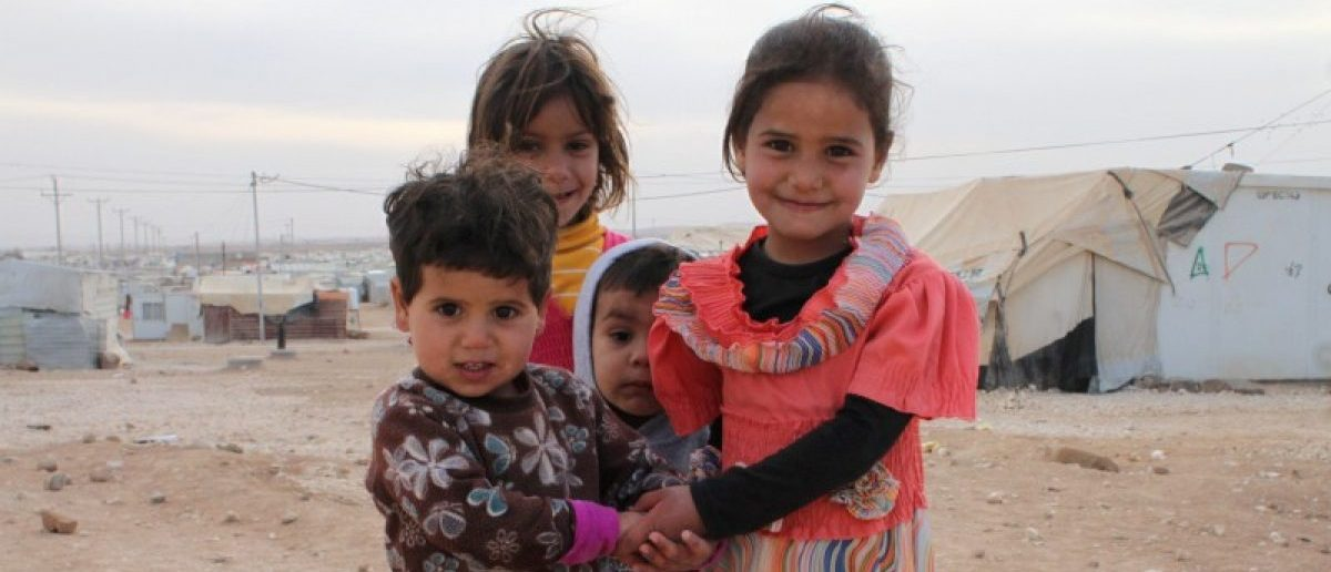 Syrian children pose for a picture at Jordan's Al Zaatari refugee camp which houses nearly 80,000 Syrian refugees, in Mafraq, Jordan November 22, 2016. Picture taken November 22, 2016. Lin Taylor/Thomson Reuters Foundation via REUTERS