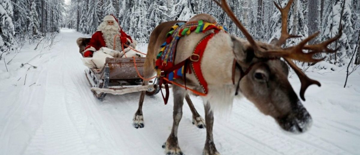 Santa Claus rides in his sleigh as he prepares for Christmas in the Arctic Circle near Rovaniemi, Finland December 15, 2016. REUTERS/Pawel Kopczynski