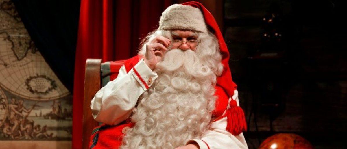 Santa Claus waits for visitors at Santa Claus' Village on the Arctic Circle near Rovaniemi, Finland December 15, 2016. REUTERS/Pawel Kopczynski