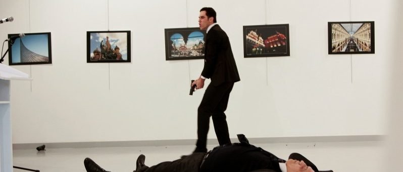 Russian Ambassador to Turkey Andrei Karlov lies on the ground after he was shot by unidentified man at an art gallery in Ankara. Hasim Kilic/Hurriyet via REUTERS