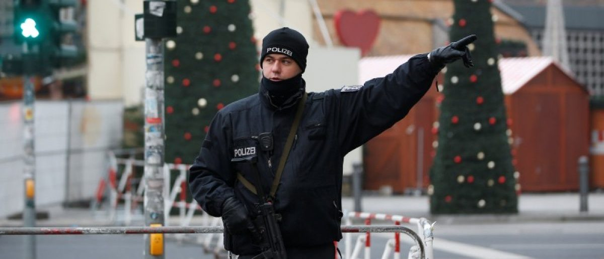 A policeman gestures near the scene where a truck ploughed into a crowded Christmas market in the German capital last night in Berlin, Germany, December 20, 2016.. REUTERS/Fabrizio Bensch