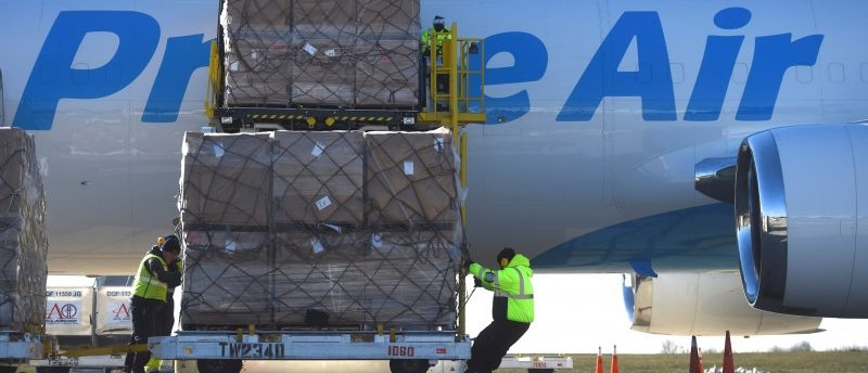 Workers unload a wide body aircraft emblazoned with Amazon's Prime logo at Lehigh Valley International Airport in Allentown, Pennsylvania, U.S. December 20, 2016. REUTERS/Mark Makela