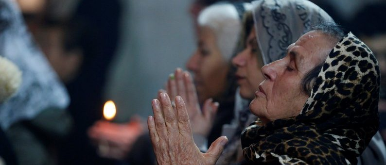 Iraqi Christians attend a mass on Christmas eve at the Mar Shemoni church in the town of Bartella east of Mosul.