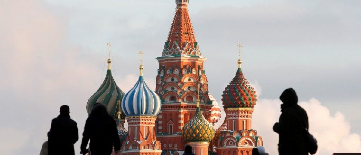 FILE PHOTO: People walk in Red Square, with St. Basil's Cathedral seen in the background, in central Moscow, Russia, February 6, 2015. REUTERS/Maxim Zmeyev/File Photo