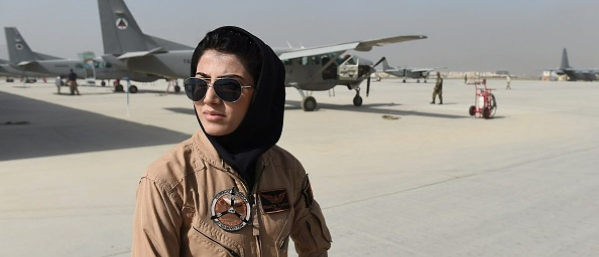 In a picture taken on April 26, 2015, Afghanistan's first female pilot Niloofar Rahmani, 23, poses for a photograph at an Air Force airfield in Kabul. With a hint of swagger in her gait, Afghanistan's first female pilot since the ouster of the Taliban is defying death threats and archaic gender stereotypes to infiltrate an almost entirely male preserve. AFP PHOTO / SHAH Marai        (Photo credit should read SHAH MARAI/AFP/Getty Images)